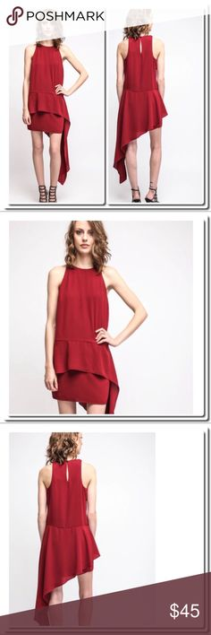 "Side Draped Mini Dress in Red Side Drape Dress in Red   Details Romantic and unexpected, this side drape mini dress by Ali & Jay is understated and unique in its flowing side accent, tiered skirt, and pop of color. It's saying so much by saying so little, you know?   Side drape mini dress Tiered skirt Hi-neck Keyhole back detail Red Interior lining 100% polyester Dry clean only Measures approximately 33"" from shoulder (mini dress), 55"" (drape accent) Model shown wearing size small (S)…"