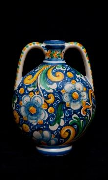 "Touch of Sicily | Flask with two handles - The decoration is Baroque with volutes, acanthus leaves, berries and peonies. The handles are highlighted by splashes of color orange yellow and green ramina. On the back a stylized white Iris blossom carries the logo ""f. Failla"" -Caltagirone -. Italian ceramic - italian pottery. #lcaltagirone #sicilia #sicily"