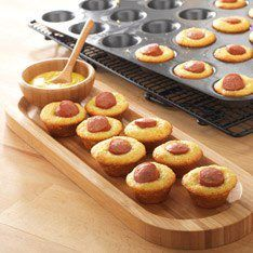 Mini Corn Dogs….Snack Size  Simply mix up an 8.5–oz. box of corn muffin mix according to package directions. Preheat the oven to 375°F and spray the Deluxe Mini–Muffin Pan with nonstick cooking spray; divide the batter among the muffin cups. Slice hot dogs into 1–inch pieces; place one piece in each muffin cup. Bake 10–12 minutes or until wooden pick in centers comes out clean.