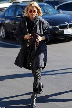 882bae72ce Sofia Richie wears Louis Vuitton Palm Spring Mini Backpack, Dear Frances  Spirit Boots and Oliver Peoples The