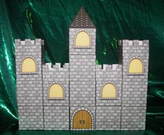 great idea for Emma's party favors - castle boxes.  I could put pictures of the princesses in the windows.