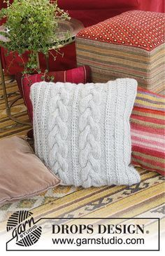Winter Snuggle Pillow - Knitted pillow with cables and false Fisherman's Rib. The piece is worked in 2 strands DROPS Air. Free knitting pattern DROPS 183-44