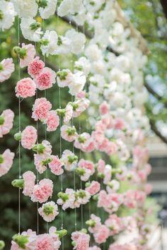 pink ombre flower wedding ceremony decor