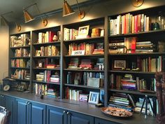 We had fun styling these bookshelves today! Our client has so many interesting mementos and treasures to intersperse with the books. And those light fixtures? Gorgeous. #sararayinteriordesign #decor #bookshelves #nashville #interiordesign