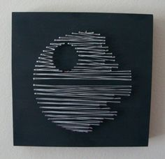 Nail & String art in the style of the Death Star, Millennium Falcon, and Darth Vaders Tie Fighter. The artwork was created on our own custom-made 1-1/2 thick wood canvases which are painted with an imperial matte black paint to contrast the rebellious light gray string.  Each one can be hung on the wall or it will stand by itself on any flat surface.  Please note that this listing is for ALL THREE pieces of artwork combined into one listing (you get 1 Death Star + 1 Millennium Falcon + 1 Tie…