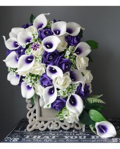 Purple Rose Cascade bouquet with purple centred calla lily and ivory roses, each of our cascade bouquets is different and created uniquely for you - choose your colours and we choose the flowers Purple Color Schemes, Purple Themes, Color Themes, Artificial Wedding Bouquets, Artificial Flowers, Ivory Roses, Purple Roses, Bridal Flowers, Flower Bouquet Wedding
