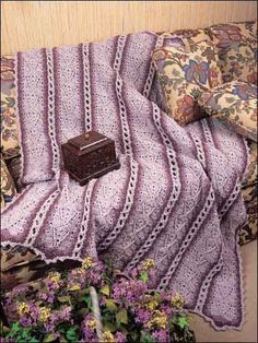 """Shells in Strips  Designed by Dorris Brooks This pretty shell pattern works up quickly in easily stitched strips. Finished size: 49"""" x 64"""". Skill Level: Easy free pdf"""