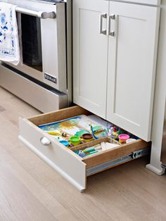 Put the toe-kick (the space between the cabinets and the floor) to work and install a shallow drawer in this underused space. Use the newfound storage spot to house kids' craft supplies or serving dishes and baking pans.