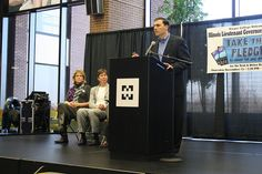 Illinois General Assembly Representative Tom Morrison speaks onstage about wanting to keep his children safe at the Texting and Driving presentation at Harper College.