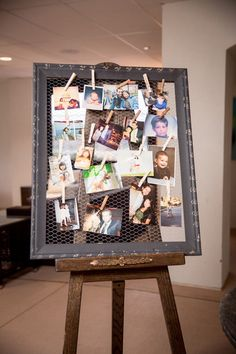 Photograph display on an easel with clothespins {Idalia Photography}