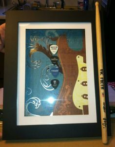 Guitar Pick holder. The handle is a drum stick and the shadow box can open to add more.