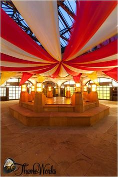 This red and white draping looks stunning. Created for a Victorian themed event we put on in which a band played on the band stand it was a wonderful scene.