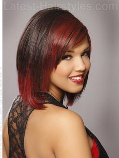 Red Vixen Dramatic Highlighted Bob Side View -- This shoulder-grazing bob haircut has a slight a-line (longer in the front than in the back) and chiseled bangs and layers around the front. Consider adding this wild red for a totally daring look!