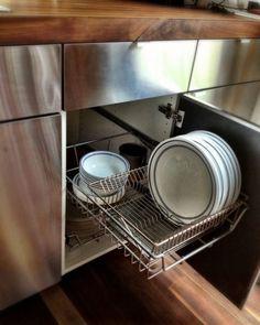 Vertical plate storage. http://tinyhousetalk.com/modern-210-sq-ft-minim-home/