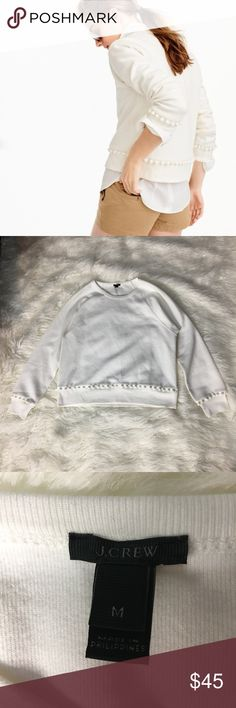 J. Crew NWOT White Pom-Pom Sweatshirt J. Crew White Pom-Pom Sweatshirt. This item is NWOT and is still in perfect condition!   Check out the rest of my closet for other items you're interested in! Bundling 3+ items means you automatically get 15% off of your entire purchase! J. Crew Tops Sweatshirts & Hoodies