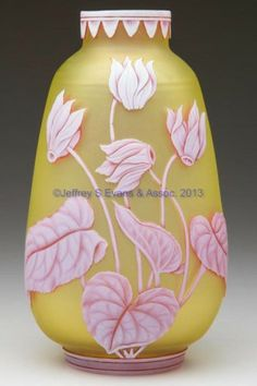 Cameo glass vase white to ruby to golden yellow with floral carving prob. by Thomas Webb & Sons, England, end of 19th Cent.