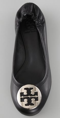 Tory Burch flats.  I have these and they're a must.  Super comfy and go pretty much with everything.