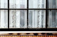 Old window, old lace curtains.