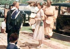 Processional welcoming Queen Elizabeth II to Tonga with Ngatu launima (tapa cloth). Tonga, central Polynesia. 1953 C.E. Multimedia performance (costume; cosmetics, including scent; chant; movement; and pandanus fiber/hibiscus fiber mats), photographic documentation.