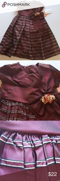 Girls dress perfect for all occasions Girls long dress Crayon from a beautique maroon with silver shiny ribbing a big bow in front and zipper and tie in back 81 %Acetate, 17%rayon 21%polyfild Dry clean only what a beauty all eyes will be on her Crayon Dresses Casual