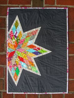 Scrappy Lone Star: quilt with link to a tutorial