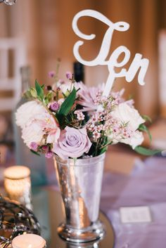 Pastel roses and carnations in vases as wedding table place cards // Wonderful Wisteria-Draped Wedding at Margaret River's Secret Garden: Arosha + Sharminie