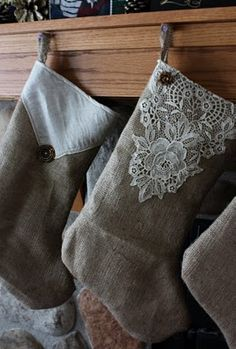 lovely  made from burlap sacks, vintage lace & buttons and repurposed linings from coats she had bought to felt  each family member designed his/her own stocking  :)