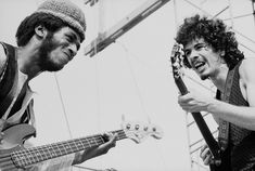 Mexican-born American musician Carlos Santana (right) and American bassist David Brown perform with the other members of Santana at 'Woodstock,' a large rock and roll music concert, Bethel, New York, August (Photo by Tucker Ransom/Getty Images) 1969 Woodstock, Festival Woodstock, Woodstock Photos, Woodstock Music, Mode Hippie, Hippie Man, Hippie Style, Happy Hippie, Bohemian Style