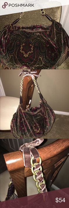 Sigrid Olsen Large Hobo Purse Designer Sigrid Olsen Large Hobo Purse. Velvet like fabric with deep hues of wine and green, beige, and other winter colors shown in a paisley pattern. Fully lined like new interior includes various sized pockets along with pen and key older. Strap includes gold tone chain accented by brown velvet bow. Leather accents on strap and interior pocket trim. Sigrid Olsen Bags Hobos