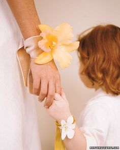 Tuck a single blossom through a slit in a wide velvet ribbon to create an elegant wrist corsage for any special occasion.