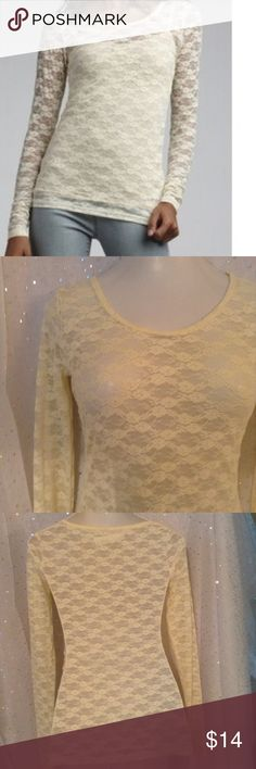 Charlotte Russe Long Sleeve All Over Lace Top Call it cream, off white, ivory, just get it soon, this is a beauty!  Model wearing a cami that is not included.  Wear your own color cami or tank for different looks!  Awesome under a blazer or cardi!  94% nylon, 6% spandex for a figure hugging stretch.  Measurements taken lying flat, UNSTRETCHED, straight across, in inches.  Length: 25.5 Bust: 17.5 Collar to bottom of sleeve: 33 Charlotte Russe Tops