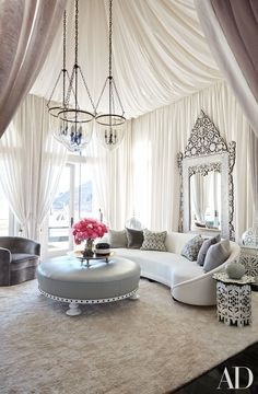 MODERN INTERIOR| Martyn Lawrence Bullard created a dreamy escape for the living room of Khloe Kardashian's California home by tenting the space with airy, sheer fabric.| http://bocadolobo.com/ #interiordesignprojects  #moderninterior