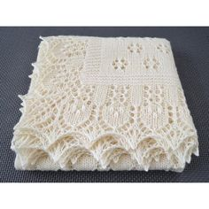 "This nature-inspired square shawl is worked in all-over lace. The style of the lace motifs is based on traditional Estonian techniques. The main square part of the shawl has a simple, yet charming floral design which creates a ""glade."" The edge worked around the main square represents a ""forest.""The pattern includes written (or row-by-row) instructions, charts, tutorials and provides a clear guidance throughout the entire process.IMPORTANT!Recommended weight of yarn is light fingering.Shown…"