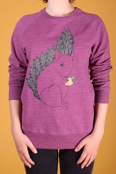 http://www.foxandfeather.co.uk/products/ragged-robin-squirrel-sweater  Black,white and gold squirrel print on a melange plum sweatshirt.