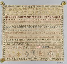 Italian Band Sampler ~ 19th century ~ silk on linen ~ alphabets and numerals ~ Metropolitan Museum of Art