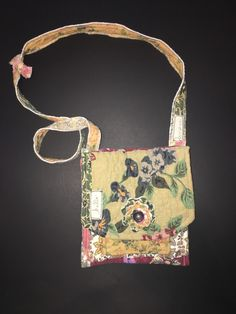 Crossbody upcycled handbag/purse - eco friendly - artsy - boho - wearable art - recycled - repurposed by DayDreamWorksByKim on Etsy https://www.etsy.com/listing/587722964/crossbody-upcycled-handbagpurse-eco