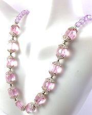http://www.ebay.com/itm/Vintage-Silver-Tone-Purple-Transparent-Bead-Choker-Necklace-/141601755938?pt=LH_DefaultDomain_0&hash=item20f81f5322