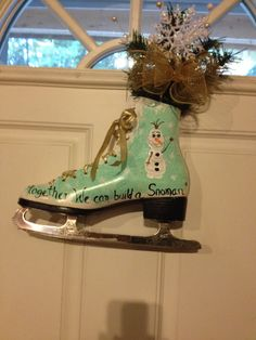 Together We Can Build a Snowman Is what Olaf says on this hand painted ice skate. A great door decoration for the winter. Hand painted with enamel paints and sealed afterward. You have a choice of silver laces and a silver bow, or gold laces and a gold bow.  This listing is for 1 skate.