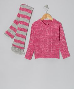 Coordinate with cozy comfort by dressing little ones in this delightful sweater and scarf duo. Borrowing from classic cool-weather elements like stripes and cable-knit accents, they're the perfect pair for keeping cuties warm and toasty.