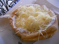 Langos - Hungarian fried dough specialty with sour cream & cheese