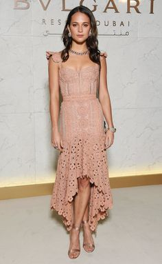Alicia Vikander in a blush lace midi dress