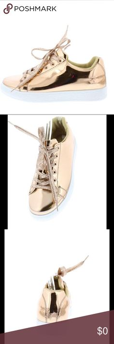 Rose Gold Mirror Finish Flat Sneaker Live in a golden state of mind in these lux sneakers! Cushioned around ankle.   Features a mirror like metallic finish. Adjustable lace up front with padded ankle collar. Flat white rubber sole.  Man made materials. Shoes Sneakers