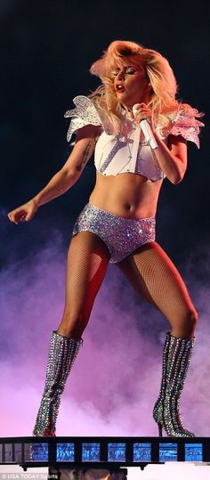 High energy: Gaga later swapped out her sequins for a pair of glitter short shorts and a w...