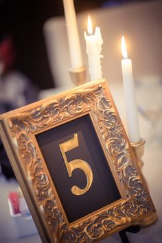 Hand-painted and designed by the couple, these gold tablescapes made the wedding reception decor pop!   Matt Steeves Photography