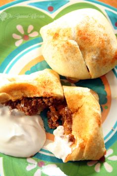 Taco Bundles are just like traditional tacos, but wrapped in a crescent roll.  Great for using up leftovers or as an easy weeknight or freezer meal.  From TheGraciousWife.com #freezercooking #tacos #weeknightdinner