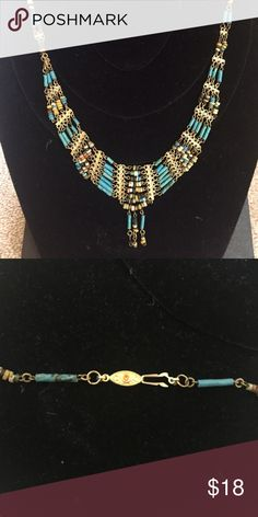 Multi-strand Beaded Statement Necklace This is a beautiful multi strand beaded statement necklace. It is embellished with turquoise colored beads, beige and brown beads, with goldtone metal and a class in the back as shown. Jewelry Necklaces
