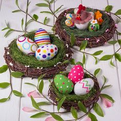 Easter eggs in a birch nest Wool light colored eggs Needle