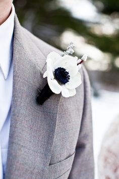 Anemone Boutonniere - Winter Wedding Inspiration from J. Schrecker Jewelry. Visit us at www.facebook.com/jschreckerjewelry