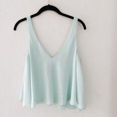 Soft Baby Blue Flowy Zara Crop Top  This cute crop top is basically brand new! I've never worn it before, just because it's not my favorite color. It's a nice pastel, soft baby blue with a cute black strap in the back. Very comfortable and flowy! No trades  Zara Tops Crop Tops