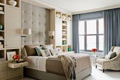 "K-tharp-design master bed with tufted wall, light sconces and ""bedside"" built in floor to ceiling cabinets"